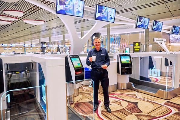 ICM CEO takes first flight from Changi T4 as Auto Bag Drop units go live