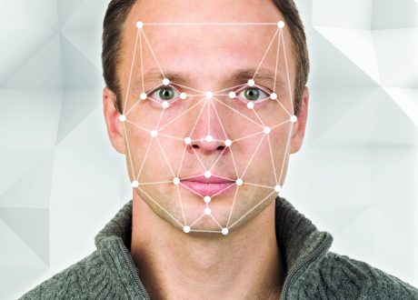Portrait of young European man with facial recognition system grid over face